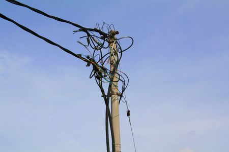 utility pole: Utility pole, cables against the sky Stock Photo