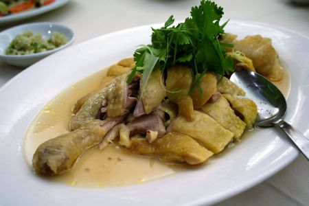 A dish of steamed chicken in a  Chinese restaurant photo
