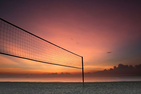 Sillhouette of a volleyball net against sunrise on the beach Stock Photo - 405791
