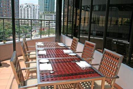 Penthouse outdoor dining, city view photo