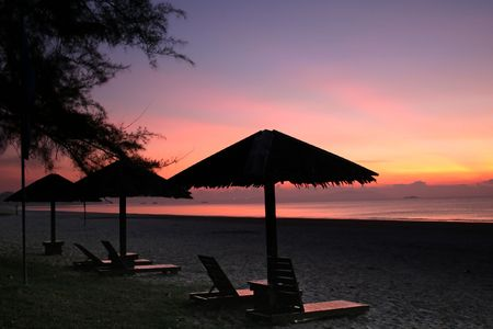 Lounge chairs on the beach, during sunrise photo