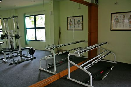 Freeweights rack in a gym photo