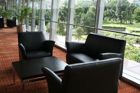 Business waiting area, leather chairs and a nice view Stock Photo - 506867