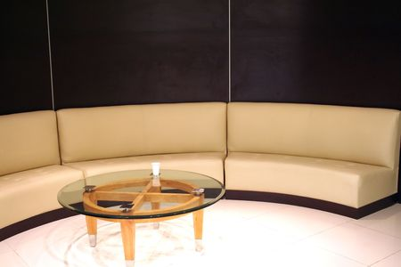 Corporate waiting area, tanned leather sofa in a curve Stock Photo - 523270