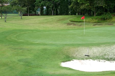Golf course, tropical greens and sand trap photo