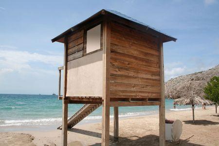 stilts: Wooden lifeguard station, raised on stilts at the beach overlooking the sea