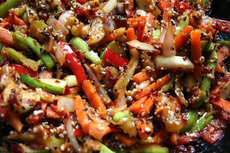 Stir-fried asian vegetables, with carrots, cucumbers and peppers photo