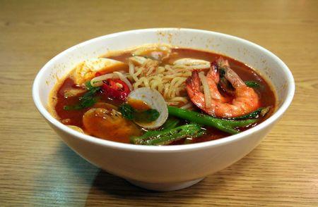 A bowl of asian seafood soup noodles