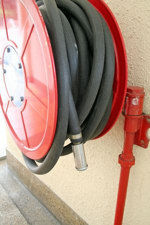 Red fire hose reel for emergency firefighting Stock Photo