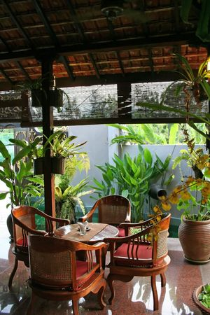 Wooden table and chairs in tropical balinese style