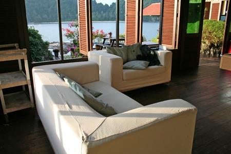 architecture bungalow: White fabric sofa with a view of the seaside