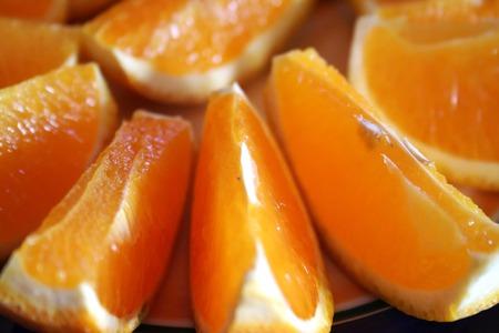 arrangment: Sliced oranges arranged spread on a plate Stock Photo