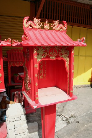 workship: Small red traditional chinese  shrine with dragon motif