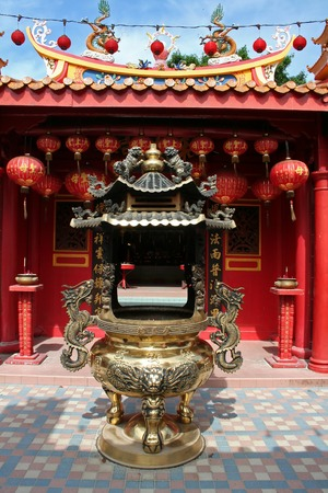 workship: Traditional chinese temple red design with brass incense holder