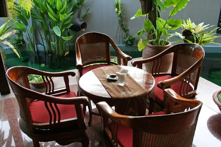 Wooden table and chairs in tropical balinese style photo