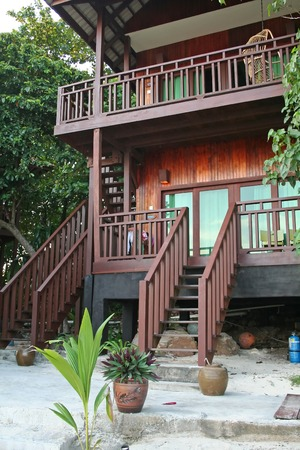 Tropical balineses style resort beach house with balcony