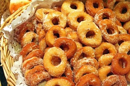 Basket of powdered sugar donuts stock photo