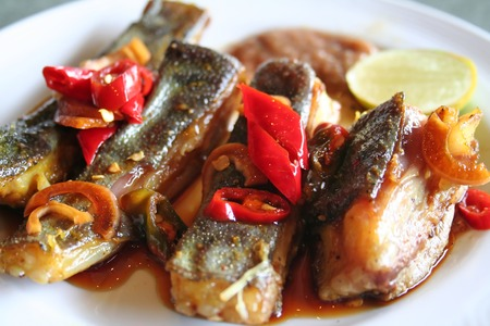 Spicy grilled rayfish traditional asian cuisine on white plate Stock Photo - 1455521