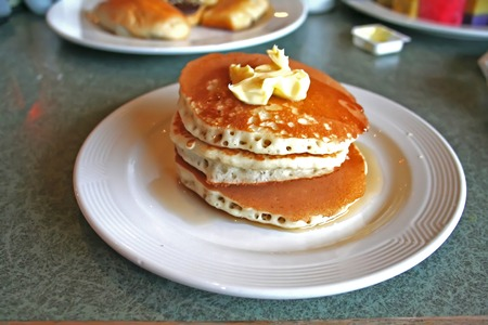 dollop: A stack of breakfast pancakes with syrup and butter Stock Photo