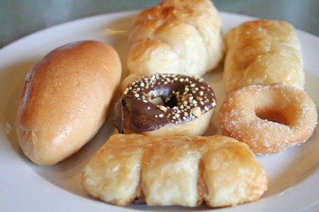 Various assorted pastries and donuts on  a plate photo