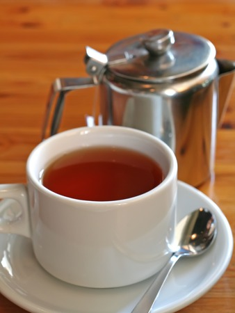 Tea served in a white ceramic cup on wooden table Stock Photo - 1499015