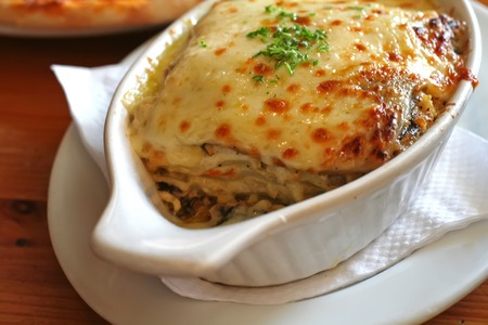 browned: Lasagna in baking dish Italian cuisine melted cheese Stock Photo
