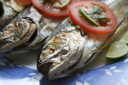 garnishing: Grilled whole fish asian cuisine spicy with garnishing Stock Photo