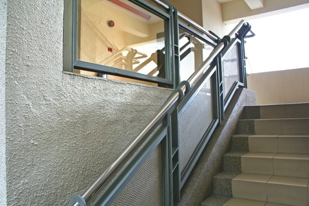 Modern glass and steel staircase reflective photo