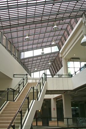 Modern glass and steel staircase and skylight photo