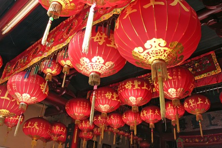 Traditional chinese temple decorated with many red lanterns photo