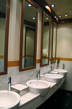 sinks: Modern washroom with round ceramic sinks