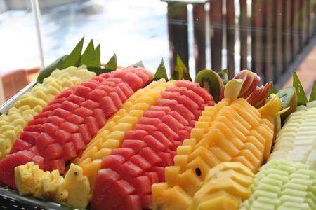 platters: Platter of cut tropical fruits watermelon pineapple