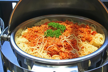 Spaghetti with sauce served in a mettal buffet tray photo