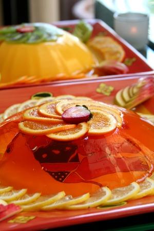 gelatine: Jelly gelatine dessert dish served with sliced oranges