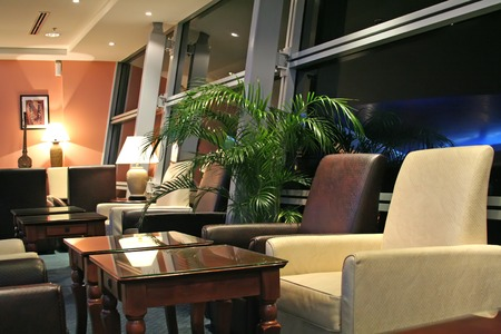 airport window: Airport business class executive lounge at night