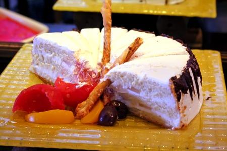 spongy: White spongy vanilla cake with icing restaurant setting Stock Photo