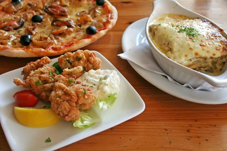 casserole dish: Traditional italian food pizza lasagna fried oysters