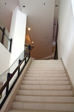 step well: Modern glass and steel staircase bright airy