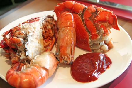 Assorted fresh cooked seafood prawns and crabs photo