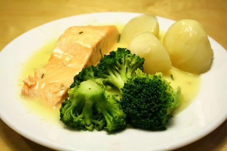 seasoned: Salmon steak in cream sauce with potatoes and broccoli
