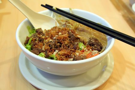 Traditional vietnamese dish of noodles and beef soup photo