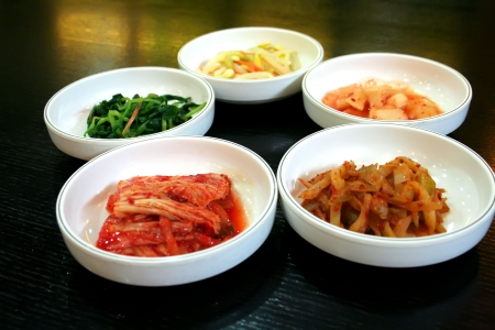 Bowls of Kimchi traditional Korean spicy vegetable pickles photo