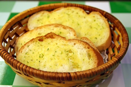 Garlic bread in a basket in restaurant setting Stock Photo - 1795983