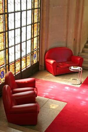 vip area: Sofas in waiting area with stained glass window