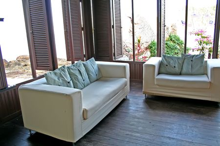 White fabric sofa with a view of the seaside photo