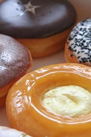 Assorted donuts varieties cream and chocolate Stock Photo - 1842508