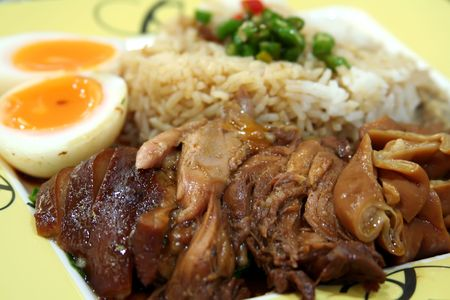 Stewed pork with soya sauce on rice traditional chinese dish photo