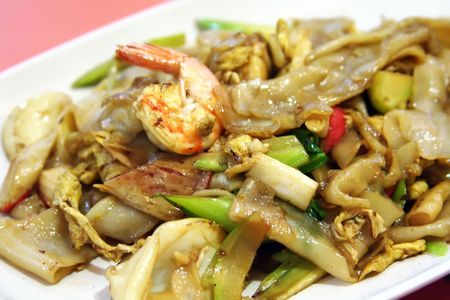 A plate of fried asian flat rice noodles with prawns photo