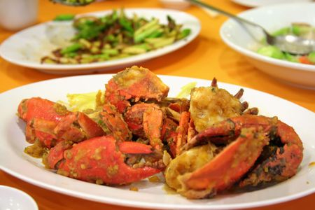 Salted egg fried crabs traditional asian cuisine restaurant setting