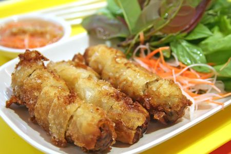 Fried vietnamese spring rolls with traditional greens Stock Photo